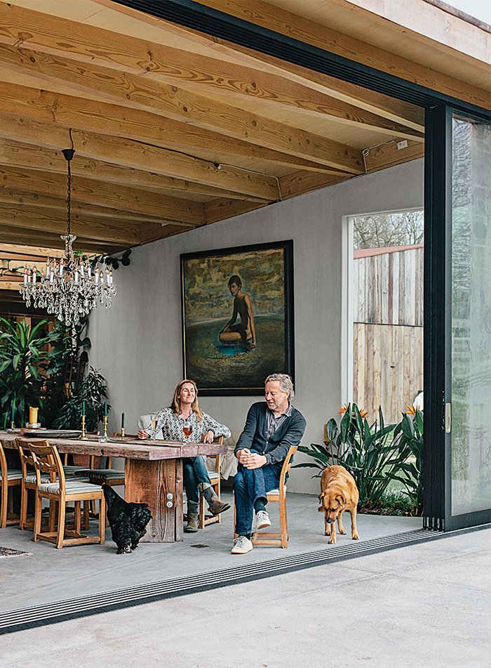 When Carlsen and Richardson moved from San Francisco to Sonoma, creating a space to entertain visitors was a priority; sliding glass doors by International Window Corporation provide a warm welcome.