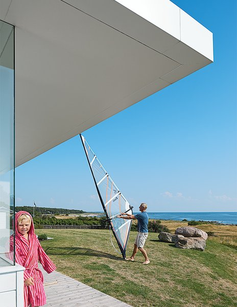 """""""The roof is my favorite part of the house,"""" says Henrik. """"It's a real challenge to get this lightness of roof with the whole construction in line with the Case Study Houses in Sweden. We have the weather here. Many houses don't get the proportions right and it looks like a hat on a house."""""""
