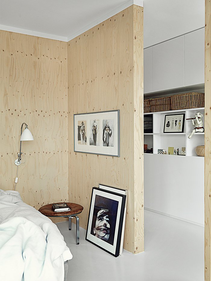 The sparsely decorated room features a PK33 stool, DUX bed, and framed photo of Björk by Anton Corbijin.  Photo 7 of 9 in Each Day at This Floating Home Begins With a Swim, Just Two Feet From Bed