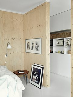The sparsely decorated room features a PK33 stool, DUX bed, and framed photo of Björk by Anton Corbijin.
