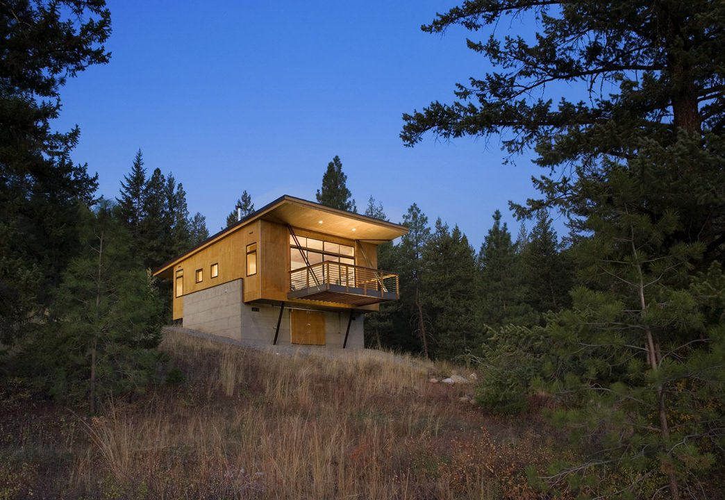 While it was tempting to embed the cabin into the hillside, Balance Associates sought a smarter solution. By elevating the project on two concrete walls, the clients could avoid a costly foundation, improve their view of the landscape, and stay above the thick winter snowfall. Tagged: Exterior, House, Cabin Building Type, Shed RoofLine, Concrete Siding Material, and Wood Siding Material.  Photo 42 of 101 in 101 Best Modern Cabins from Simple Cabin Embraces Its Mountain Setting