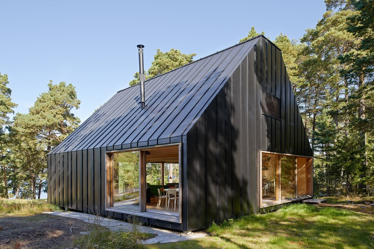 This dwelling joins a number of structures—such as a boathouse and guesthouse—owned by one family and used for vacations. They needed a new house to accommodate new generations at the reatreat. Tagged: Exterior, Metal Siding Material, House, Cabin Building Type, and Gable RoofLine.  Photo 95 of 101 in 101 Best Modern Cabins from This Island Retreat Practically Embodies Simple, Rugged Scandinavian Design