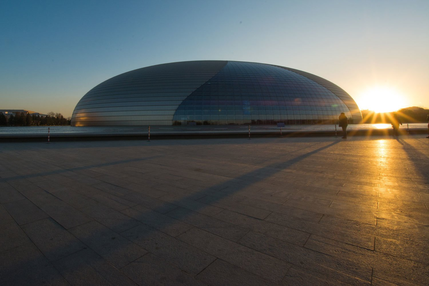 This titanium and glass dome-shaped National Centre for the Performing Arts Opera House was a point of contention when it debuted in late 2007 because many people felt its egg-like structure, designed by French architect Paul Andreu, disrupted the feng shui of the capital. Check their schedule to catch touring orchestras, ballet troupes, and of course, Peking opera.  Photo 10 of 10 in 10 Places to Visit in Beijing