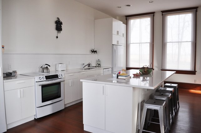 The updated kitchen boasts new cabinetry and appliances.  20+ Modern Home Eat-in Kitchens by Erika Heet from Living in a 1912 Schoolhouse