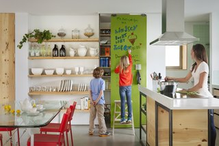 10 Best Modern Kitchens - Photo 8 of 10 - IdeaPaint recruited their onsite artist, Derek Cascio, to create a special wall for kids to color and scribble on in the Modern Family Pavilion.