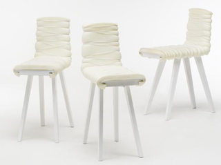 Bistro Light<br><br>Upholstered chair with slightly distorted proportions, which enable new ways of using the chair. Limited edition. Manufactured by Thorsen Møbler.