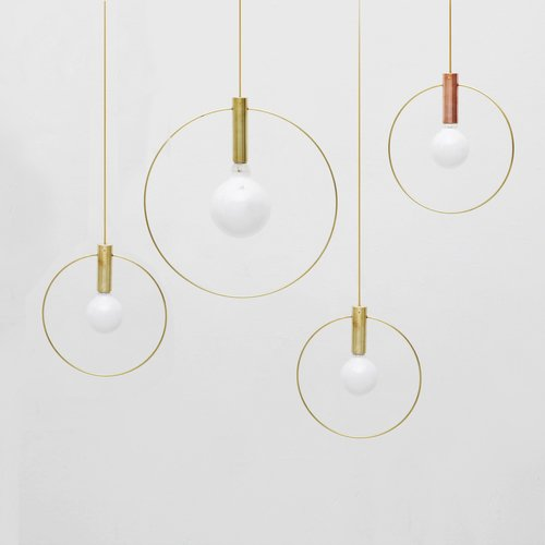 Aura LightsA pared down pendant lamp that comes in a brass or copper base and a 10-or 15-inch brass ring. From $345 Lighting by Michael Yang