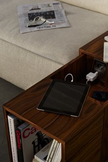 The concealed charging station slides out easily. Photo provided by Cassina.