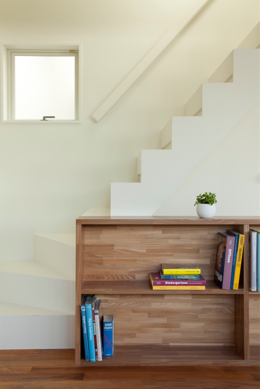The staircase was painted white to promote uniformity of design. Photo 6 of Half & Half House modern home