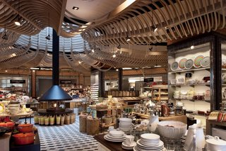 Upon entering the store, the customer is transported into a busy market, much like those in Mexico, where he or she can purchase food products, housewares, utensils, etc. The space is brought up to date through the scupltural wood canopy that moves the eye toward the center of the space.