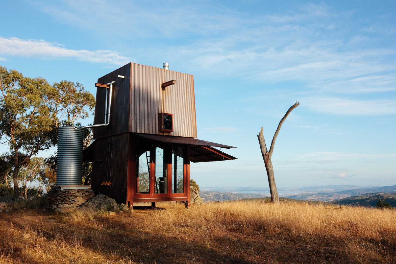 Rainwater is collected from the rooftop of the Permanent Camping! Mudgee abode by Casey Brown, NSW, Australia. Photo by Penny Clay  Cabin by DAVE MORIN from 100 Contemporary Green Buildings