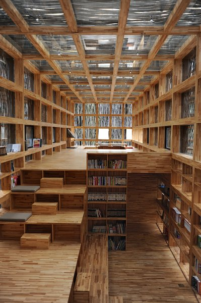 The Li Yuan Library's coffered walls provide a built-in storage solutions for all those books. Li Xiaodong, Li Yuan Library, Jiaojiehe Village, Huirou, Beijing, China. Photo by Li Xiaodong Atelier.  Read by DAVE MORIN from Wood Architecture Now! Volume 2 by Philip Jodidio