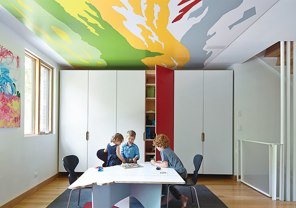 The ceilings in the children's rooms and playroom feature abstract details from Thomas Hart Benton paintings. Hufft Projects designed the marker-board table, which was cut in the shape of the state of Missouri. This Kansas City Home Looks Like Its Neighbors, But Reveals a Truly Modern Sensibility - Photo 6 of 10