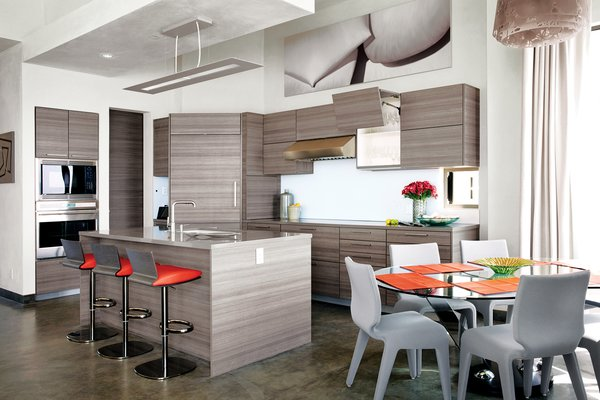 Cranston collaborated with project designer John A. Turturro and builder Bryan Henson of Allen Associates on the 2,400-square-foot house. The architect of record is Larry Graves of Alliance Design Group. Eco-conscious materials were key: In the kitchen, Poggenpohl cabinets were chosen for their recycled wood content and for the company's low-waste factory efficiency. The Sub-Zero Wolf refrigerator uses less energy than a 100-watt light bulb.  Roche Bobois Ublo barstools pull up to the kitchen island; a Reduced fixture from Louis Poulsen hangs above. The dining area features a Lunch Time dining table and Chabada chairs, also from Roche Bobois.  To learn more about the Cranston Residence project and its players, please visit www.3palmsproject.com