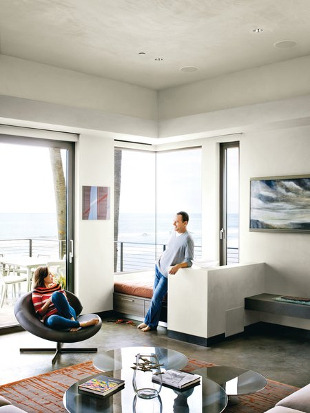 Bryan and Robin relax in a corner of the living room; the custom rug is from the Rug Affair.<br><br>To learn more about the Cranston Residence project and its players, please visit www.3palmsproject.com