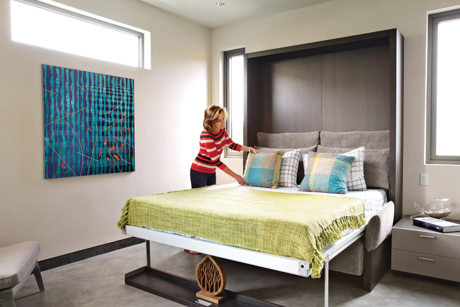 Robin adds the finishing touch to the Murphy bed system from Clei/Resource Furniture.  Photo 1 of 18 in Actor Bryan Cranston's Green Beach House Renovation