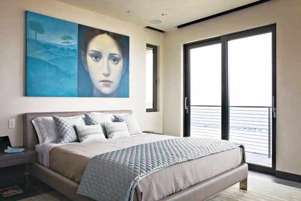 In the master bedroom, Azul Giorgione by Alberto Gálvez hangs above a locally manufactured bed from Soluzioni. The sheets, pillow cases and blanket are from Restoration Hardware; the decorative pillows and quilted coverlet are from Bed, Bath, and Beyond. <br><br>To learn more about the Cranston Residence project and its players, please visit www.3palmsproject.com
