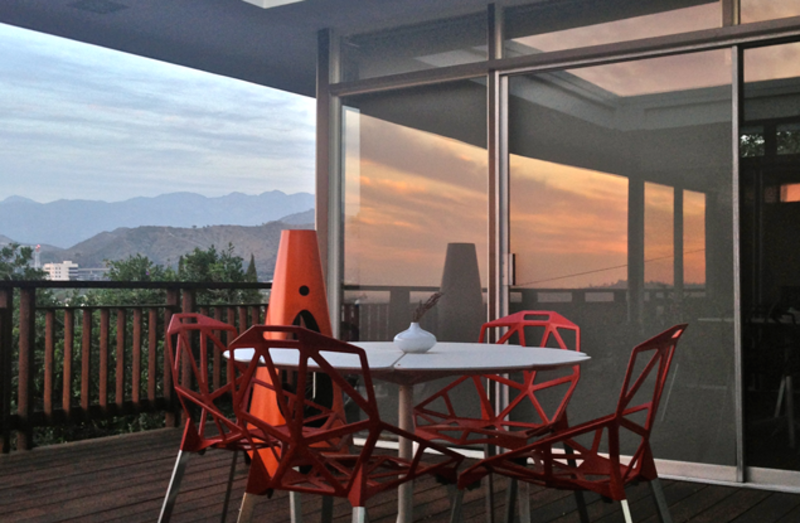 The deck of H House, which has incredible views, includes chairs by Konstantin Grcic.