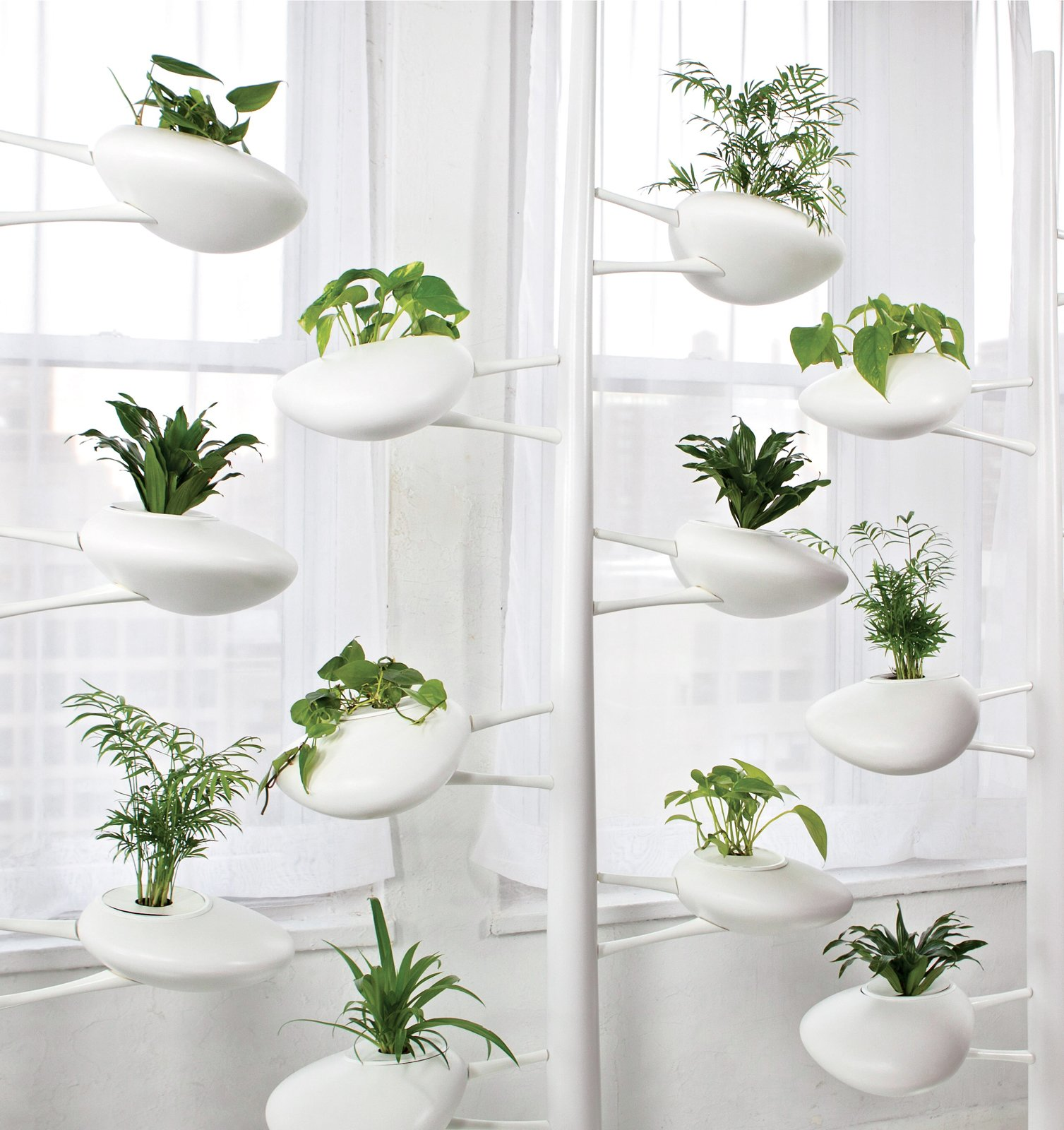 Danielle Trofe DesignThe Live Screen is an indoor planter system that uses self-sustaining, hydroponic technology.  20+ Ways to Design with Planters by Allie Weiss from 6 Noteworthy Designs from Salone Satellite 2013