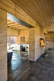"A Sustainable Rammed Earth Home in New Mexico - Photo 3 of 5 - Marrying the interior with the outdoors informed the design, as did the concept of subtraction: ""If you do it with two, then you can do it with one,"" Maniatis says, articulating Roger's algebra of minimalism. Photo by: Kirk Gittings"
