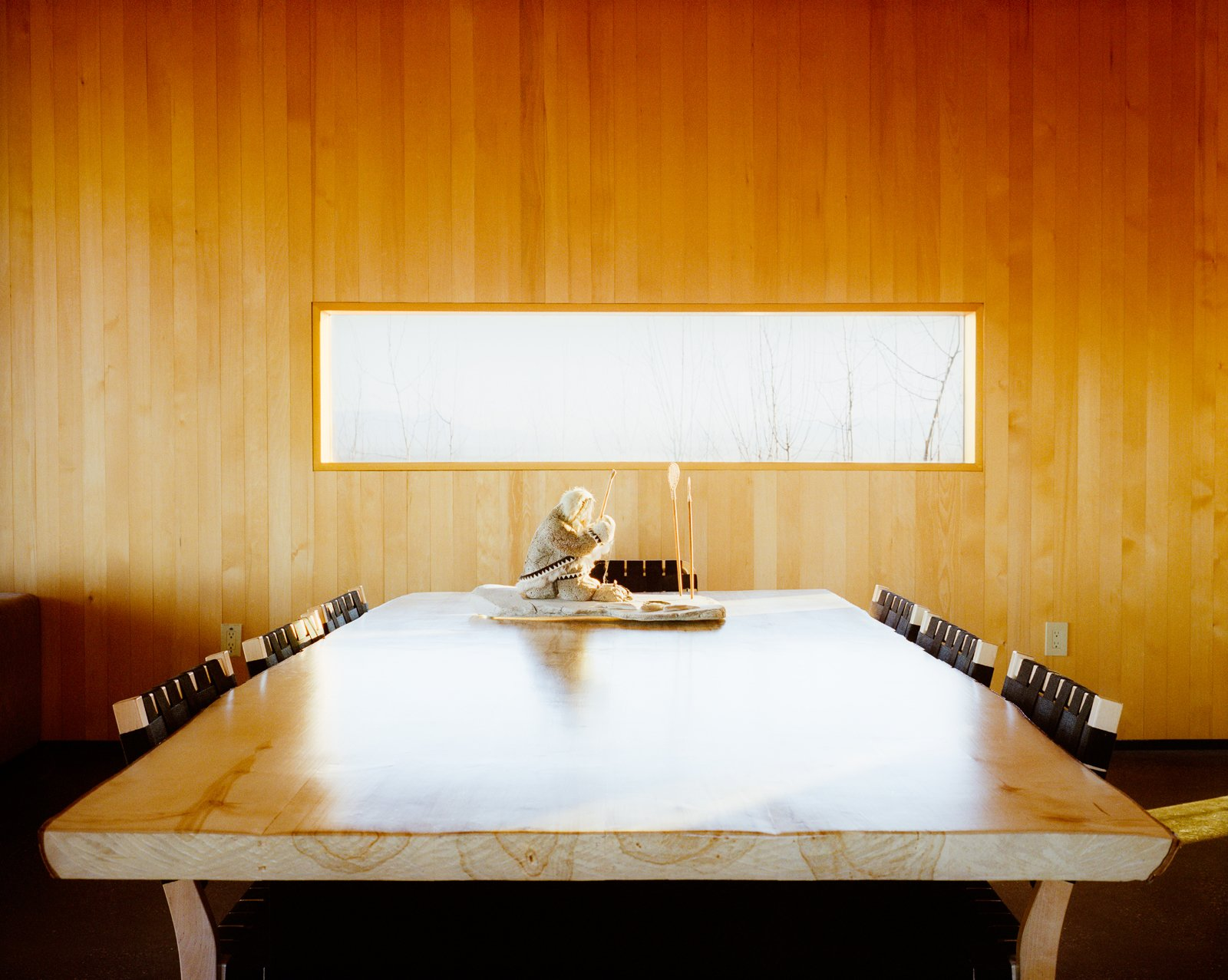 Buser made the dining table which is surrounded by Chair 611s by Alvar Aalto for Artek. Tagged: Dining Room and Chair.  Photo 3 of 20 in This Modern Cabin Is the Ideal HQ For a Family in Alaska