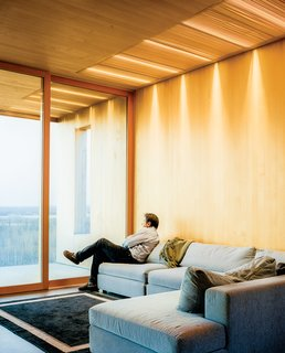 This Modern Cabin Is the Ideal HQ For a Family in Alaska - Photo 5 of 19 - The living room features a sofa by Dellarobbia.
