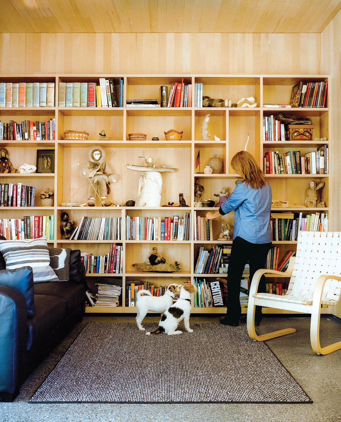 Architects Mayer Sattler-Smith designed the bookshelves and Alvar Aalto the 406 lounge chair for Artek. Tagged: Living Room, Chair, and Bookcase.  Photo 9 of 20 in This Modern Cabin Is the Ideal HQ For a Family in Alaska