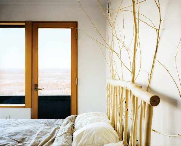 Buser designed and made the headboard in the master bedroom from local aspens.