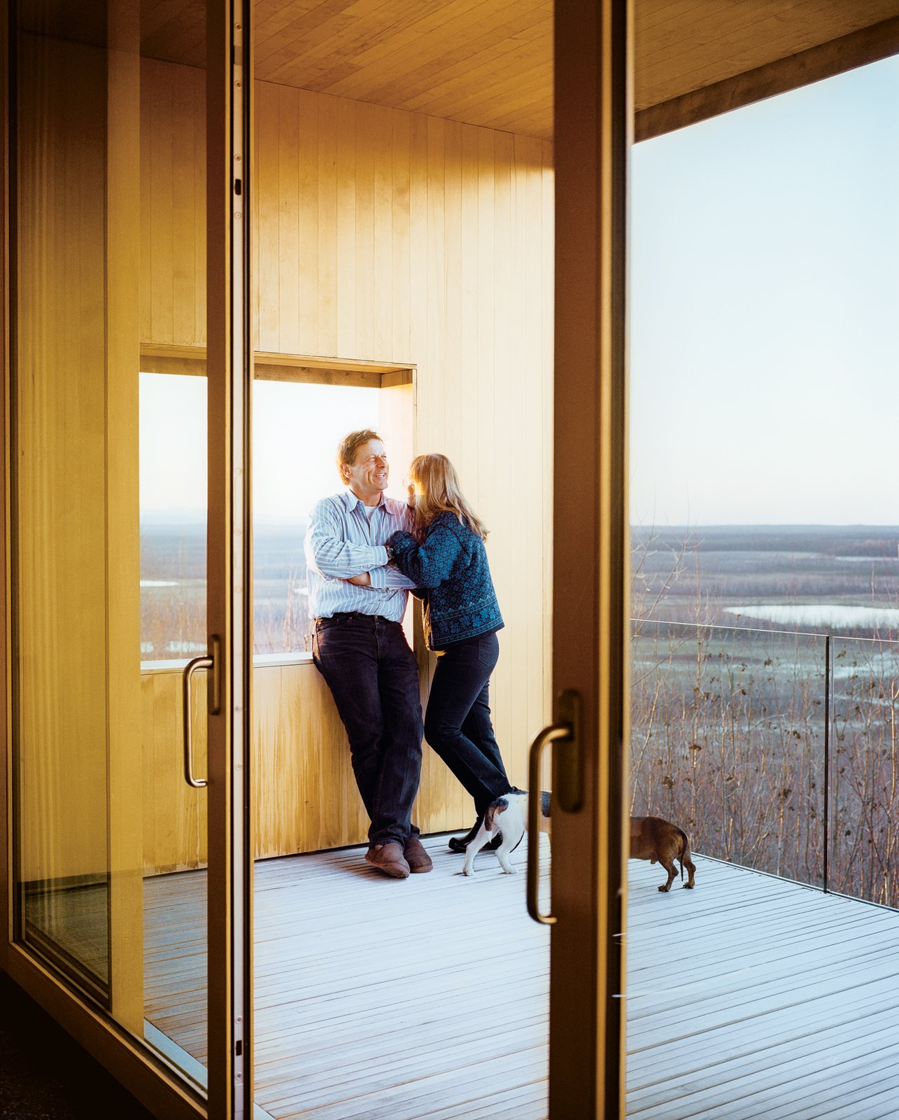 The sliding doors to a deck are by the Canadian company Dynamic Architectural Windows & Doors. Tagged: Doors, Exterior, and Sliding Door Type.  Photo 13 of 20 in This Modern Cabin Is the Ideal HQ For a Family in Alaska