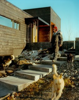 This Modern Cabin Is the Ideal HQ For a Family in Alaska - Photo 16 of 19 - Perched on top of a hill, the house is accessed by a long staircase that runs up to the exterior courtyard. The dogs, naturally, take their own route.