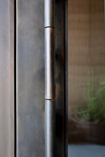 American Made Design: Dust - Photo 2 of 4 - Dust designed this door handle with a mechanism similar to that of unlocking a vault—it opens with ease even though the door is heavy.
