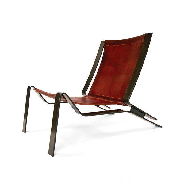 The Larrea lounge combines a latigo leather sling seat with a powder-coated steel frame.