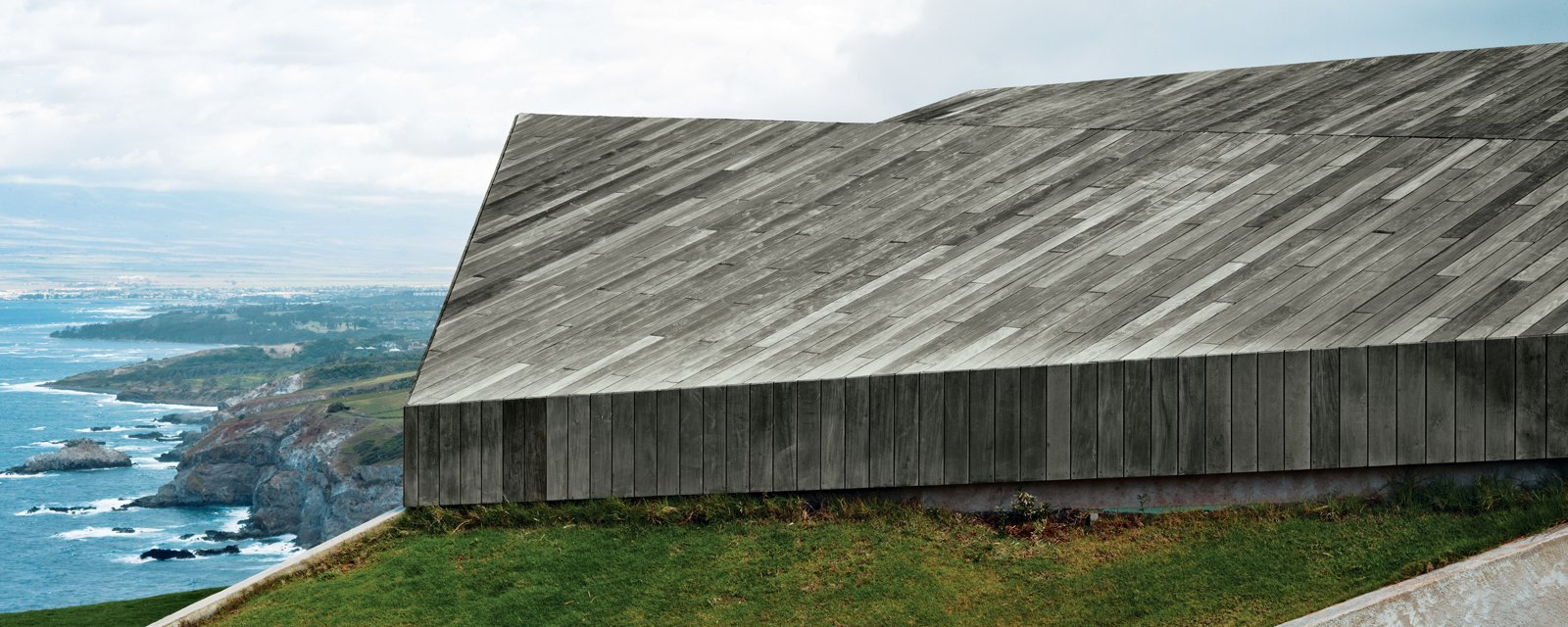 """""""In this house, the roof is the only facade—the rest is dissolved beneath it."""" —Architect Aljoša Dekleva Tagged: Exterior, House, and Wood Siding Material.  Photo 8 of 10 in Clifftop House with Angled Roof in Maui"""