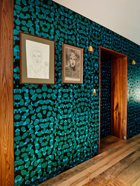 The once public hallway between the two apartments now boasts a bold wallpaper by Kravitz Design for Flavor Paper.