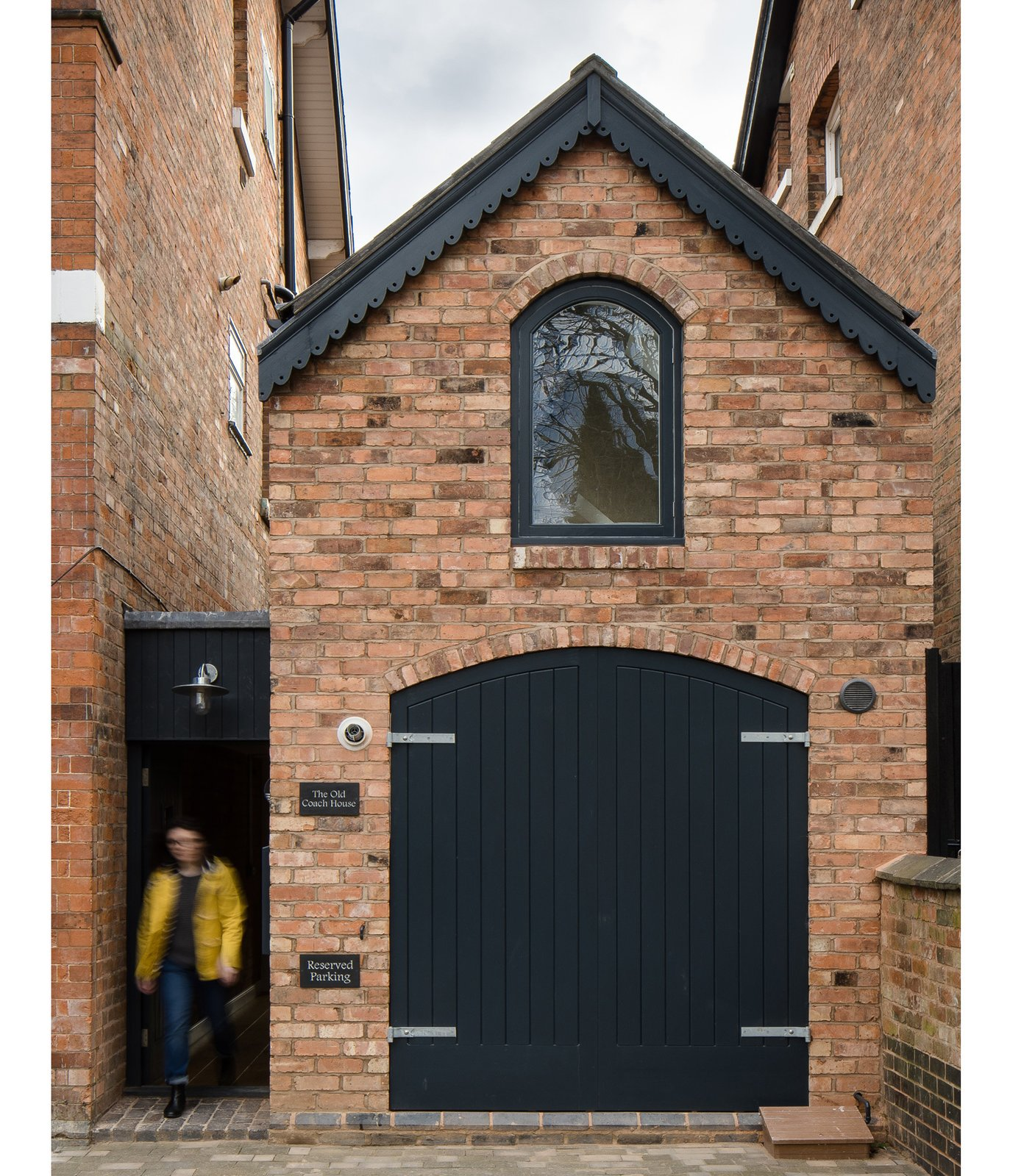 Faux timber doors, painted black, along with a brick facade help the dwelling blend with its surroundings: the Victorian homes of the Moseley neighborhood in Birmingham, UK.  Photo 4 of 21 in A Spotlight on 10 Traditional Homes with Modern Interiors from We Love This Adorable Writer's Studio Camouflaged as a Coach House