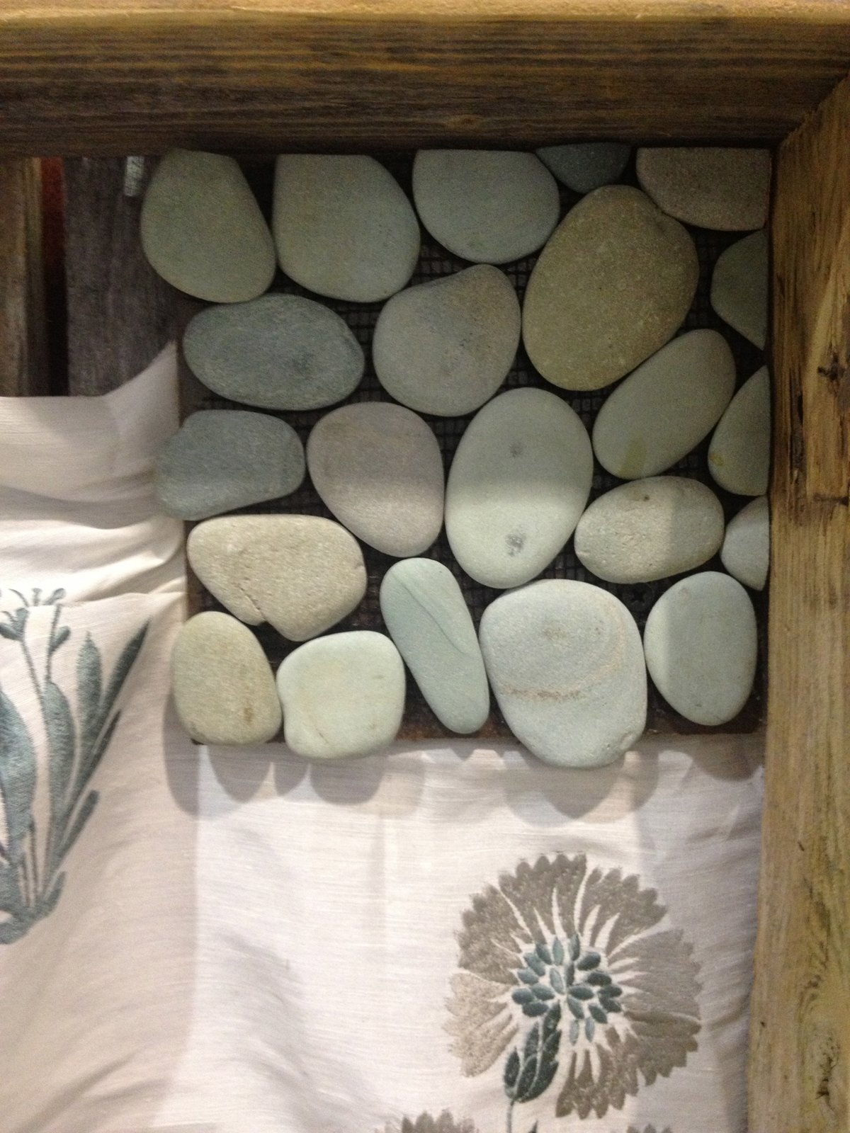 Natural pebbles join fabric on Broeder's board.  Pinboards Come to Life in the Pinterest Pavilion by Erika Heet