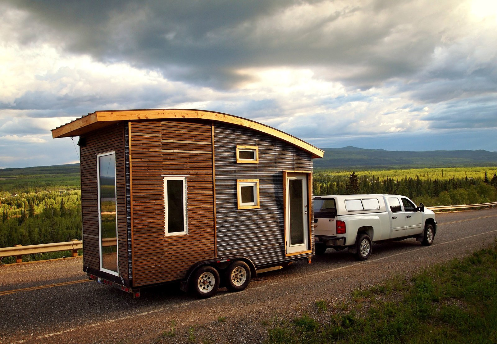 The Leaf House is a lightweight, mobile trailer that was carefully engineered to weigh less than 5,000 pounds. The designer, Laird Herbert, used a metal-mesh, open-joint rainscreen as the cladding on the front end, and spruce pine at the back. Tagged: Exterior, Curved RoofLine, Camper Building Type, Wood Siding Material, and Metal Siding Material.  Tiny Homes by Scott Saunders from A Modern Trailer is an Experiment in Small-Space Living