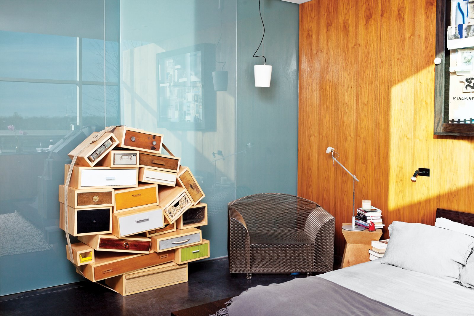 The master bedroom features a Chest of Drawers by Tejo Remy for Droog and a How High the Moon chair by Shiro Kuramata.  Photo 5 of 10 in An Architect References Local Architecture to Build a Modern Home