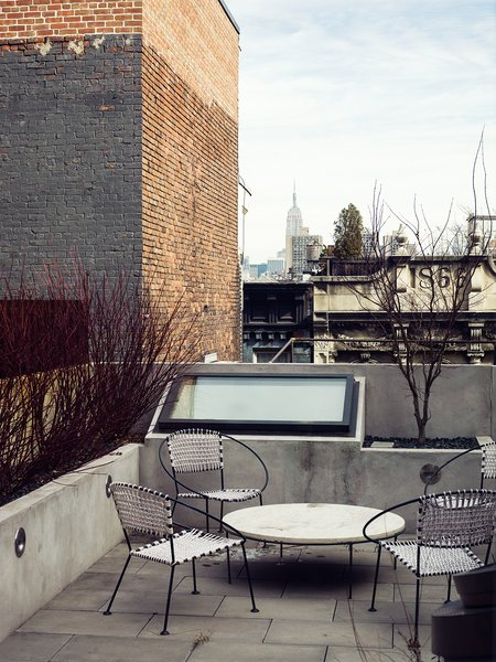 Pulltab's ingenious skylit lightwells visible from the terrace Marcovitz and Geiger requested for the newly built-out second-floor roof terrace. The outdoor table is vintage Paul McCobb.