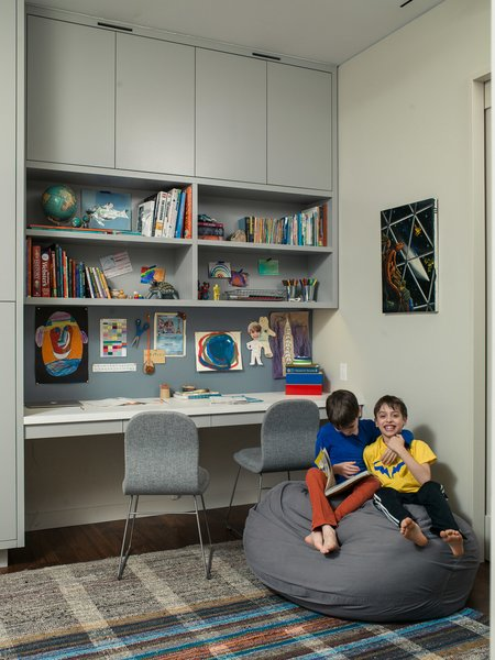 Houldin, 10, and Jonas, 8, in the boys' shared work area-slash-playroom. The vintage kilim rug was purchased at Double Knot and the desk chairs are by Jasper Morrison for Cappellini.