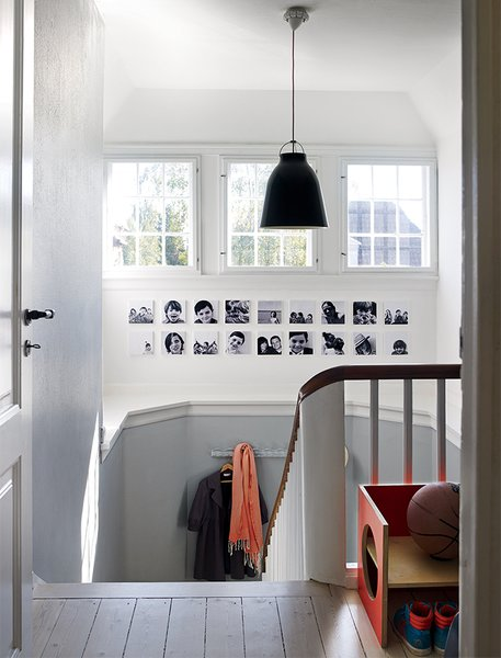 In the Denmark home of designer Eglantine Charrier, original 1920s windows and moldings meet modern accessories like a black Caravaggio pendant lamp by Cecilie Manz for Lightyears.