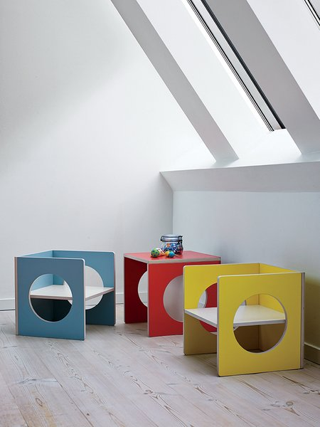 The house is filled with pieces from Small-Design, the children's furniture company cofounded by Charrier, including the transformable Cube, which does double duty as a chair or table in the top floor kitchen-dining area.