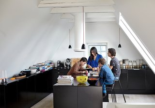 With three sons in the family, the kitchen gets a lot of use. Hee barstools by Hee Welling for Hay slide up to a multi-functioning island where the family gathers to eat, study and play.