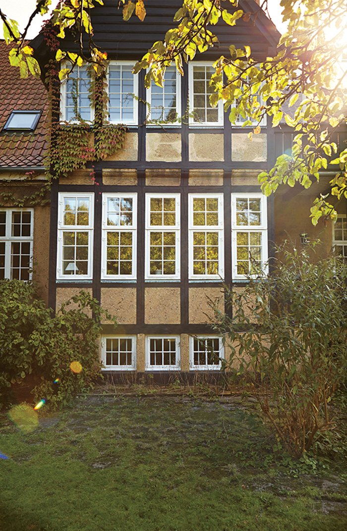 The family, who reside on the top two floors of this two-family Tudor-style house, kept many of the building's original windows.  Modern Danish Homes We Love by Aileen Kwun from A Cramped Attic Became a Sunny Dining Room in this Renovation of a Copenhagen Tudor