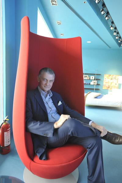 Giulio Cappellini sits in a Tulip chair by Marcel Wanders for Haworth Collection.