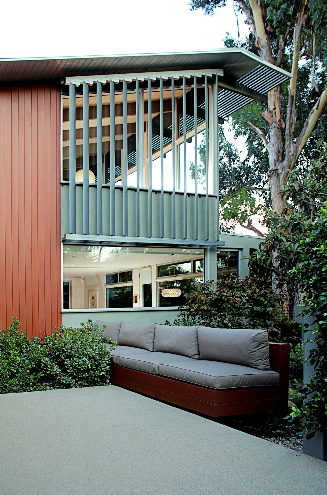 The second-story addition has a view of the Santa Monica Bay. Electronically controlled aluminum slats by LouverTech filter street noise and sunlight. Midcentury Homes by Dwell
