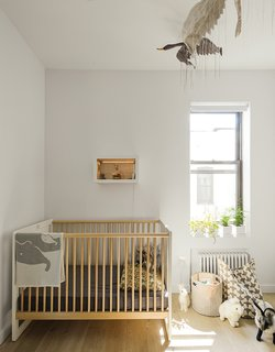 Schmidt selected Oeuf's Robin crib for Finn's soon-to-be sibling. The bird mobile is by Tamar Mogendorff.