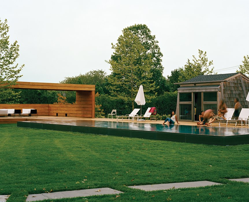 Masi also turned the miniscule guest quarters into a pool house. Tagged: Outdoor, Large Pools, Tubs, Shower, and Grass.  Photo 7 of 9 in Modern Wood-Lined Family Home in the Hamptons