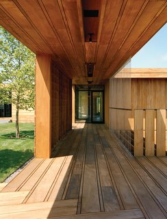 Modern Wood-Lined Family Home in the Hamptons - Photo 8 of 9 - Contractor Keith Romeo worked with Bates Masi on the varied mahogany planks used for the exterior decking, which are finished simply with wood toner by Cabot.