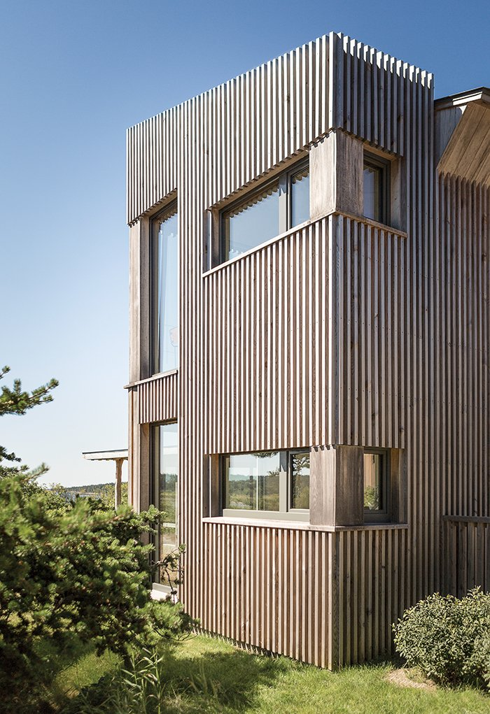 "The exterior is clad in eastern hemlock. ""It's local, it's native, and it's actually got a good bit of resistance,"" Winkelman says of the material, ""and we could mill it to a unique dimension."""